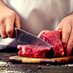 man cutting meat