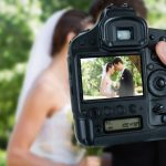 wedding photographer taking pictures of couple